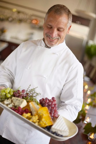 Chef with Fruit and Cheese Platter