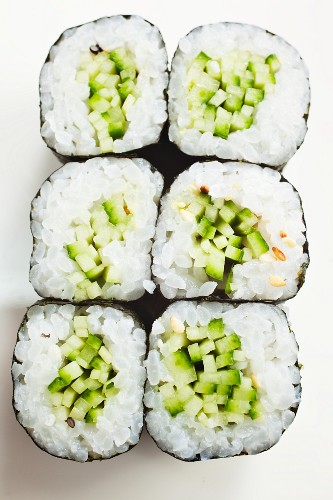 Maki sushi with cucumber and sesame seeds