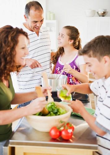 Hispanic family preparing dinner together
