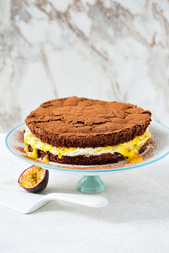 Chocolate mousse cake with cream and passion fruits