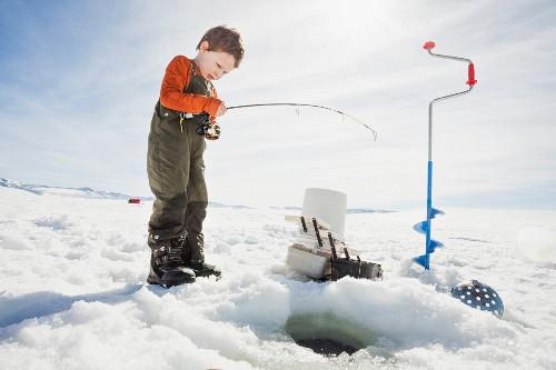 A little boy ice fishing