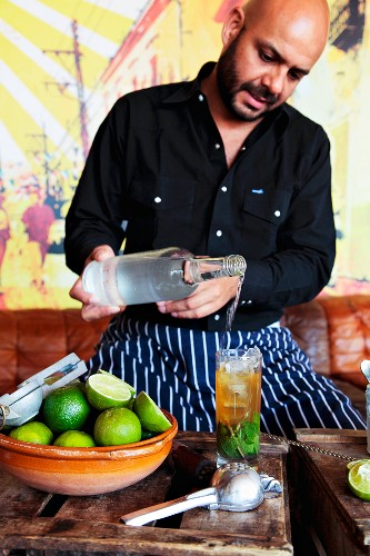 A mojito being made (white rum being added)