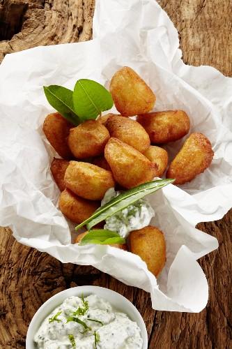 Potato doughnuts with a wild herb dip