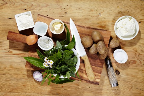 Ingredients for making potato doughnuts with a wild herb dip