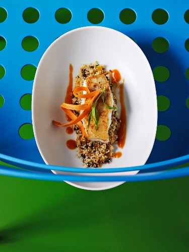 Cod fillet with ginger and carrot sauce on a bed of couscous
