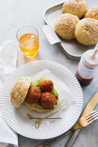 A gluten free hamburger made with meatballs