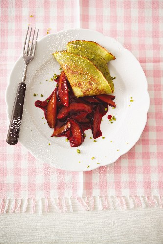 Chopped plums with a pistachio crepe
