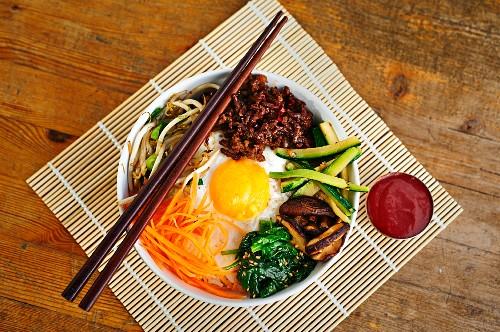 Bibimbap - Korean rice dish with vegetables, beef and gochujang