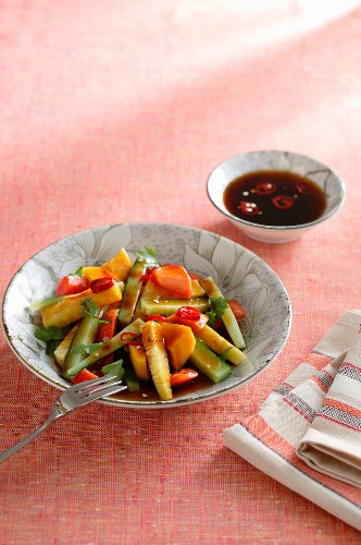 A fruit and vegetable salad with spicy chilli sauce