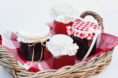 Damson jam and medlar jelly in a basket as a Christmas gift