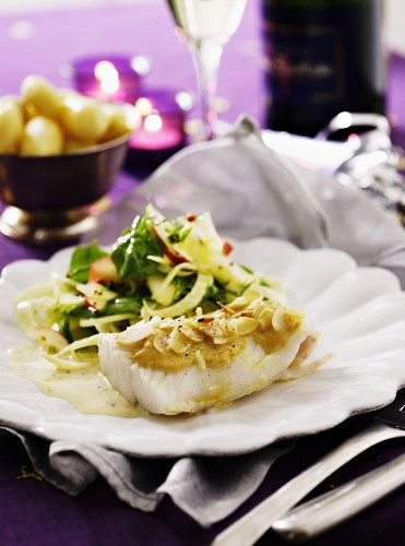 Cod fillet with a mustard and almond sauce served with an apple and fennel salad