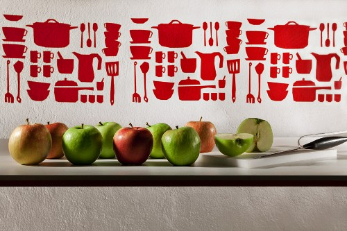 Various apples on a kitchen counter