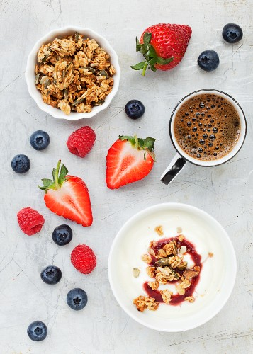 Yogurt muesli, fresh berries and black coffee