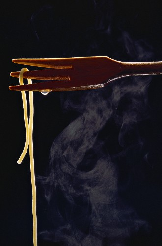Single Strand of Steaming Spaghetti on Fork