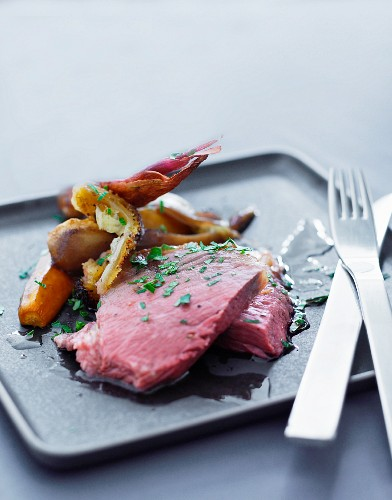 Boiled beef with root vegetables