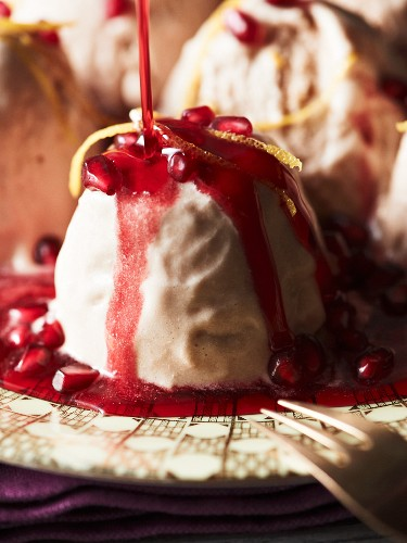 pomegranate parfait with orange zest and syrup
