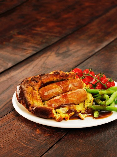 Toad in the hole with beans and tomatoes
