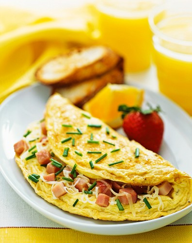 Ham and cheese omelette served with orange juice