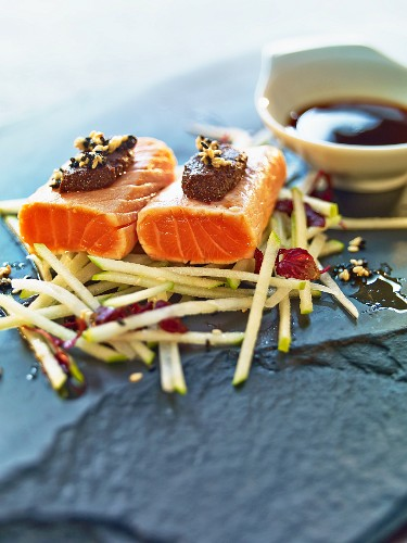Scottish smoked salmon with olive cream on a bed of apples and radishes served with a soy-mirin sauce