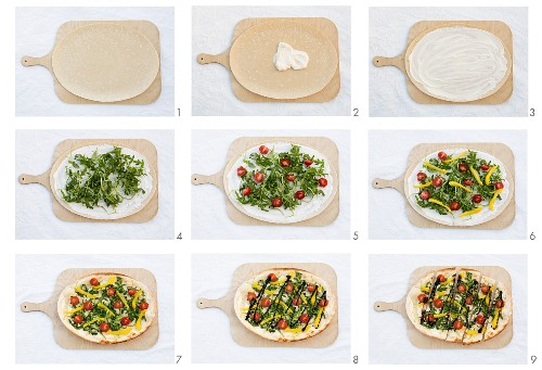 Vegetable pizza with rocket, cherry tomatoes and pepper being made