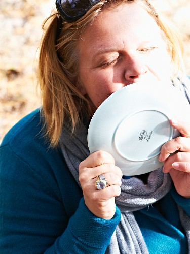 A woman licking a cake plate