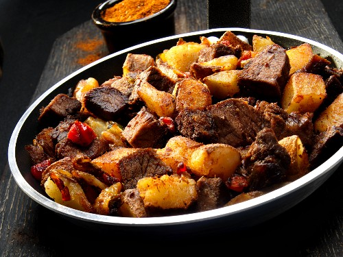 Beef with potatoes, onions and Cajun spices