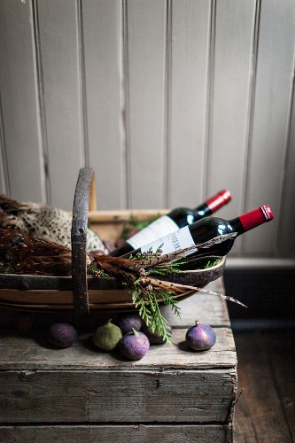 An arrangement featuring pheasant, red wine and figs