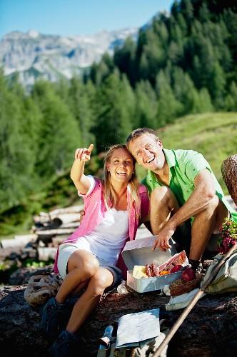 A couple having a picnic in the mountains (Austria)