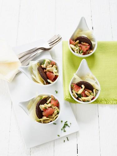 Artichoke and grapefruit salad with pumpernickel