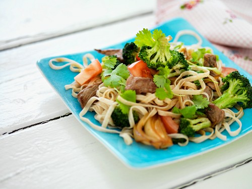 Noodle salad with broccoli, pork and vegetables