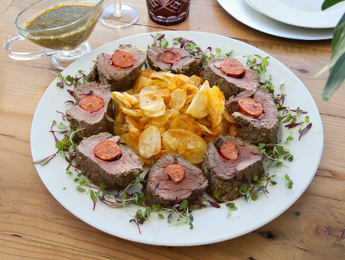 Beef fillet filled with chorizo and a herb crust served with homemade potato crisps