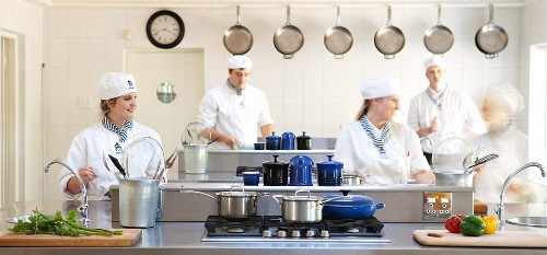 Trainee chefs in a kitchen