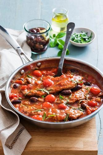 Vitello alla caprese (veal escalope in tomato sauce with olives)