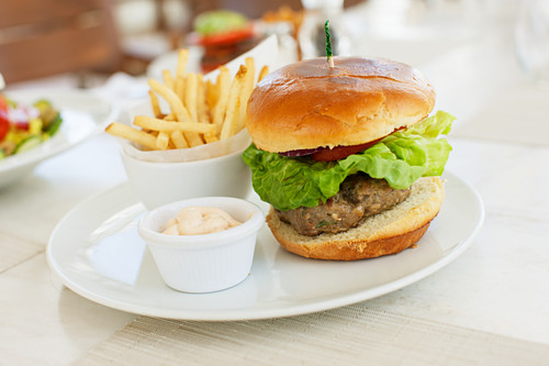 A hHamburger with fries in a cafe in South Beach, Miami, Florida