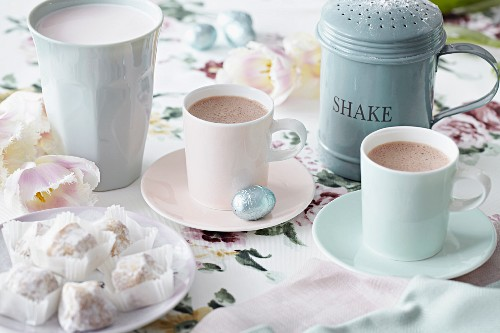 Two cups of hot chocolate with sweets