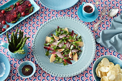 A bird's eye view of beetroot and herb salad with dressings