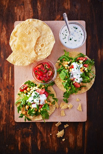 Poppadoms served with a tomato and chickpea salad and yogurt