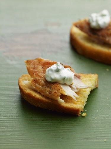 Bruschetta with smoked mackerel and sour cream