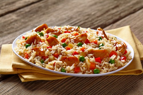 Rice with chicken, peas, carrots and peppers