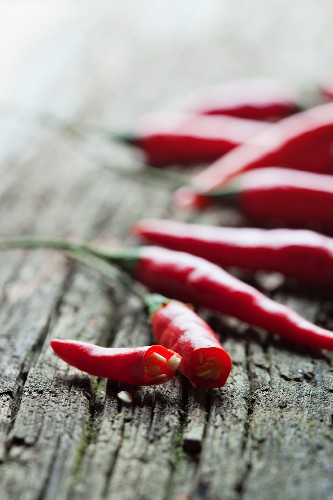 Fresh red chilli peppers on the wooden surface
