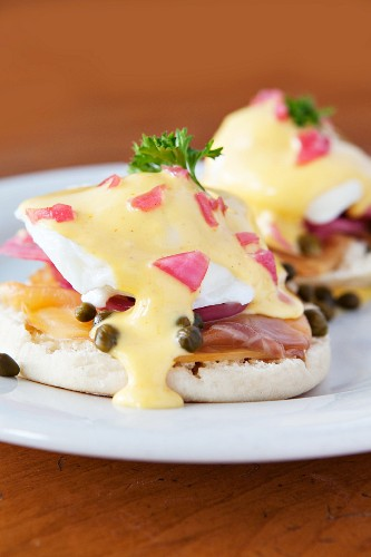English muffins topped with poached eggs, caramelised onions, smoked salmon, capers and Hollandaise sauce