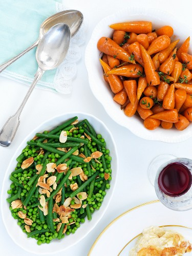 Vegetable side dishes for Easter: peas and beans with flaked almonds, and glazed baby carrots