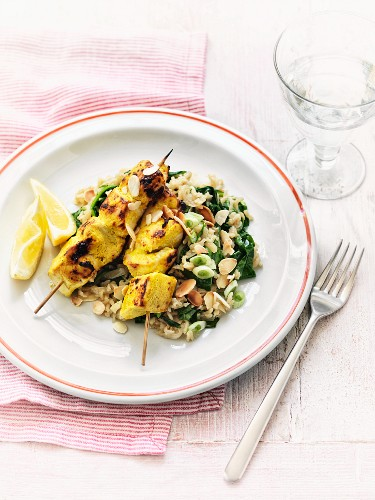 Chicken skewers with almond and spinach rice