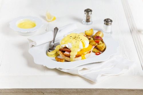 Eggs Benedict with potatoes for breakfast