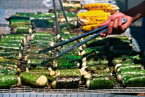 Sticky rice wrapped in banana leaves on a grill at the Vietnamese Lunar New Year Festival in Footscray, a suburb of Melbourne, Victoria, Australia