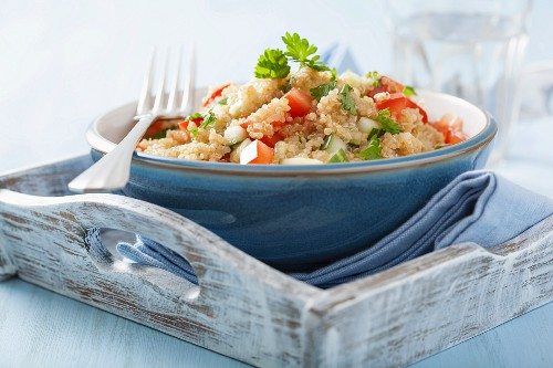 Quinoa salad with tomatoes, cucumber and parsley