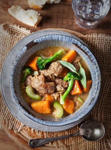 Pork stew with broccoli, celery, sweet potatoes and sage