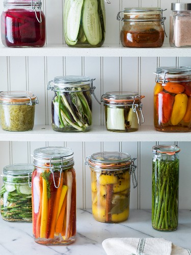 Preserved fruit and vegetables on shelves in a pantry