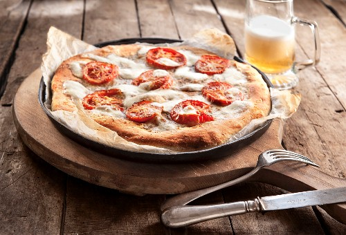 Margherita pizza and beer