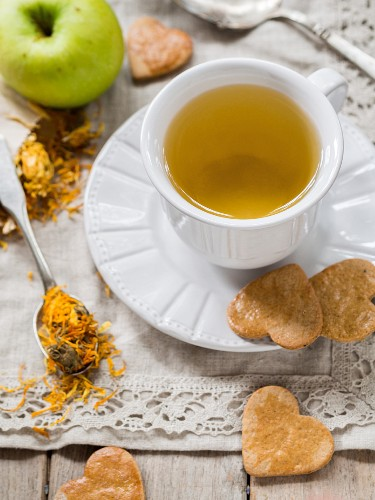 Marigold tea and heart-shaped biscuits